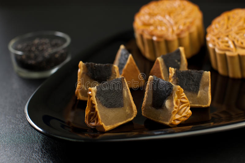 Black Sesame Flavor Mooncake with White Lotus Seed. Chinese mid autumn festival food stock photo
