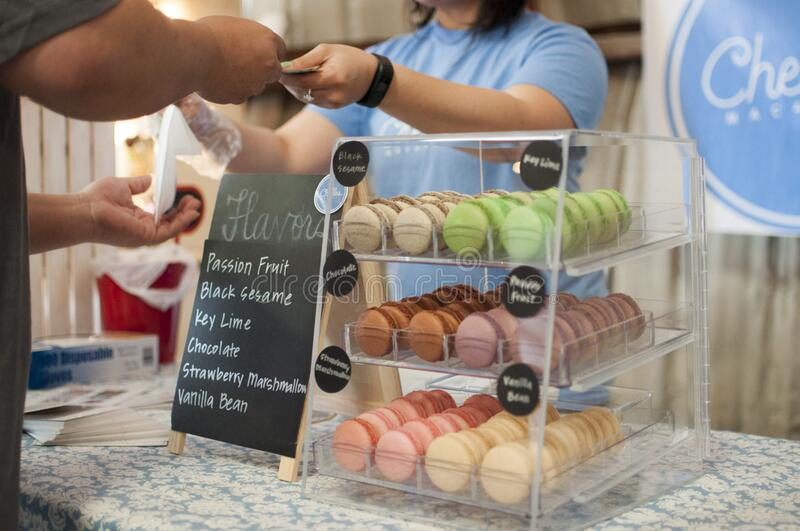 Black Sesame Key Lime Chocolate and Strawberry Macarons in a Glass Display stock photography