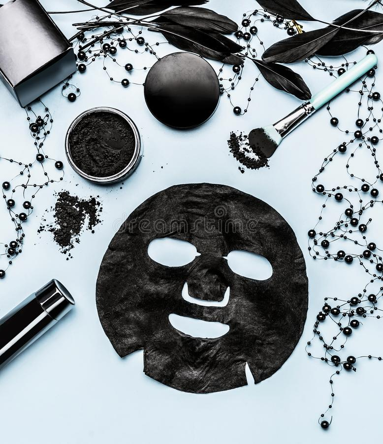 Black sheet mask and cosmetic products setting with Activated Charcoal, top view. Beauty. And modern skin care concept. Branding mock up royalty free stock photo