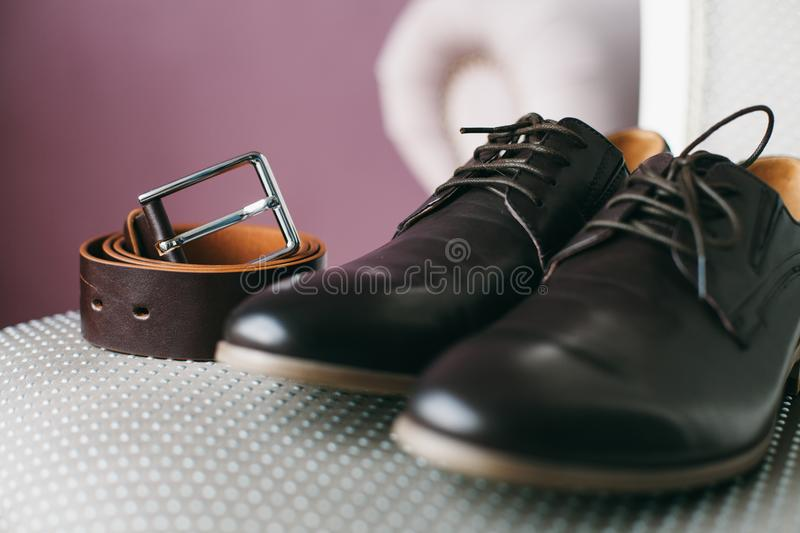 Black shoes and belt on chair royalty free stock photo