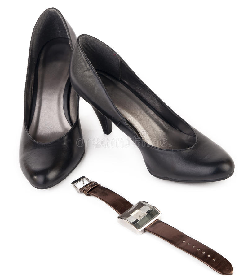 Black shoes and brown watch for women stock images