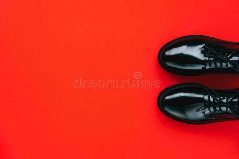 Black shoes on a red background. Black friday concept royalty free stock image