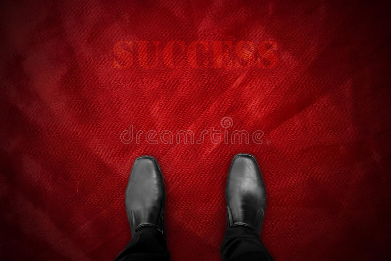 Black shoes on red carpet royalty free stock image