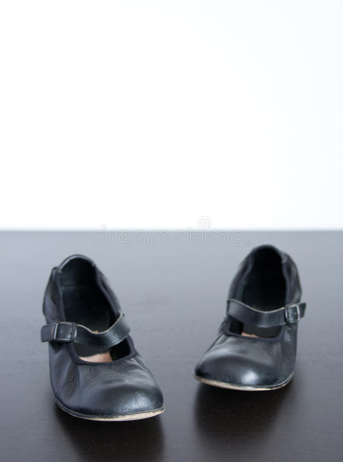 Black Shoes On Wooden Surface Royalty Free Stock Images