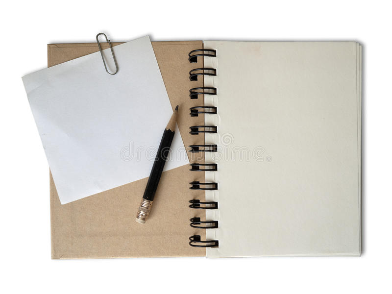 Black shot pencil on Recycle paper notebook. And white note paper isolated with shadow royalty free stock photography