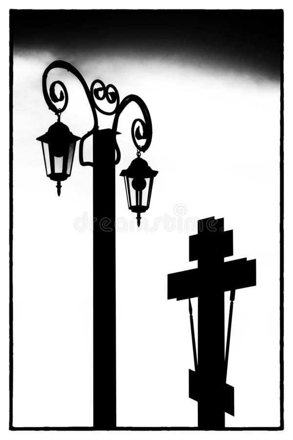 Black silhouette of an Orthodox cross and lantern in a black frame on a white background stock images
