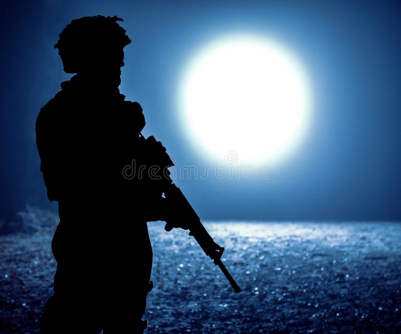 Black silhouette of soldier stock image