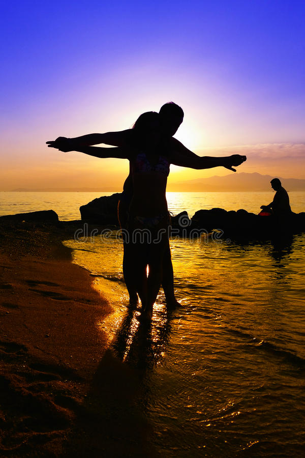 Black silhouettes of a lovers couple royalty free stock image