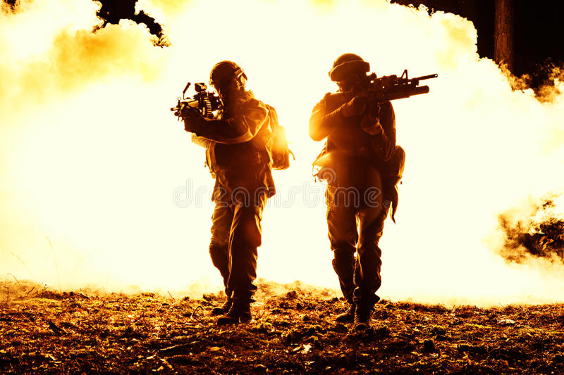 Black silhouettes of soldiers royalty free stock photography