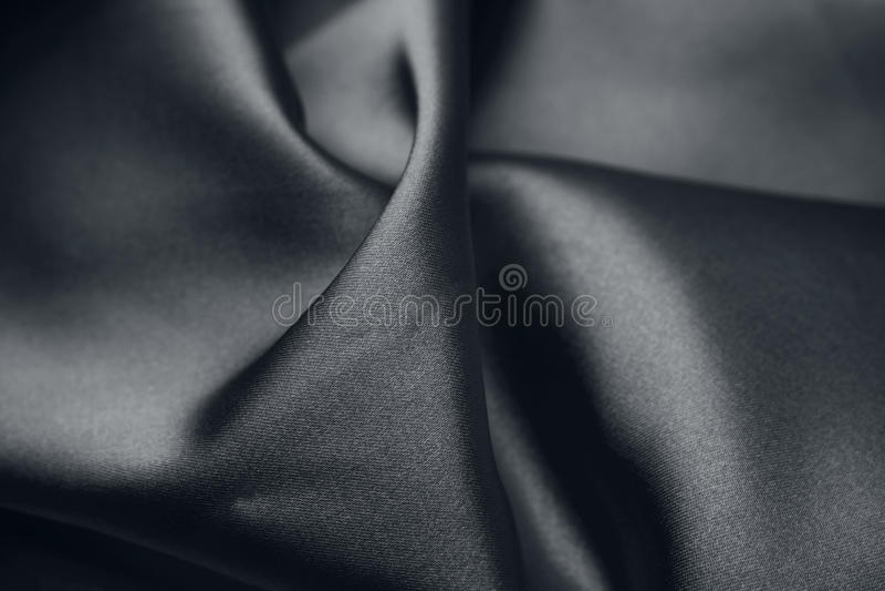 Black silk. Closeup of rippled black silk fabric stock photos