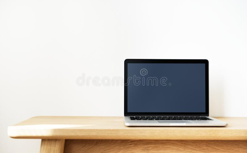 Black and Silver Laptop Computer on Brown Wooden Desk stock photo
