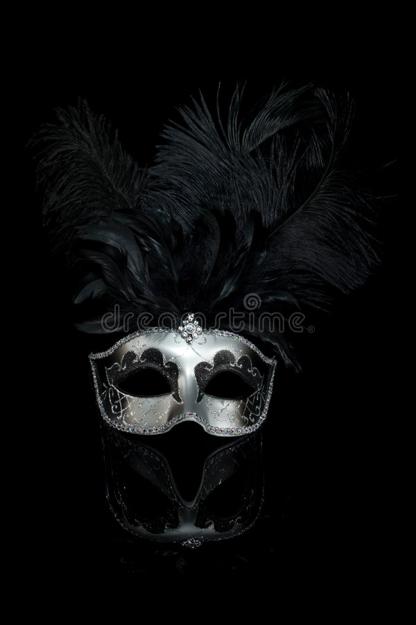 Black Silver Venetian Carnival Mask. With feathers isolated on black background stock image