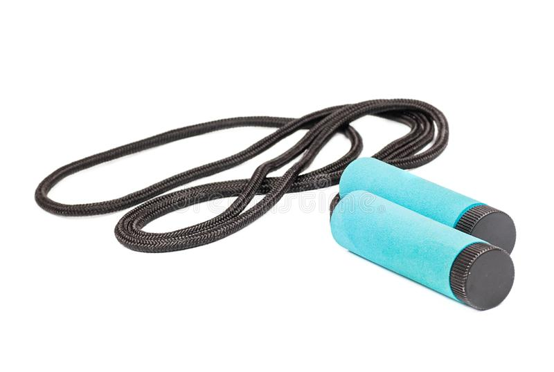 Black Skipping rope. With blue handles isolated on white royalty free stock photography