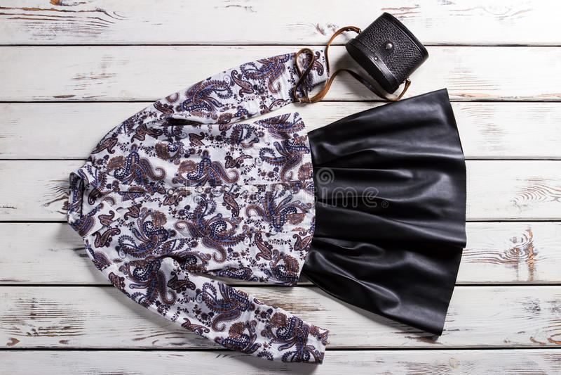 Black skirt with floral shirt. stock photos