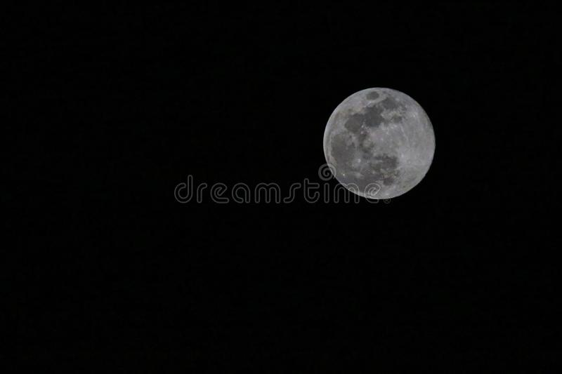 Full moon sky black craters stock photography