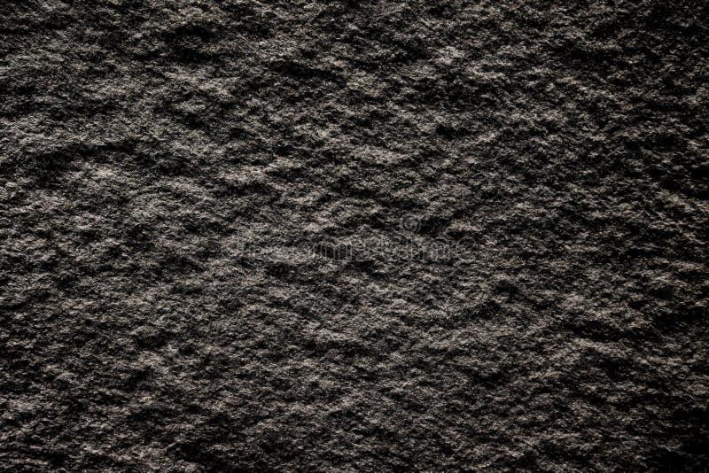 Black slate stone, dark grey texture patterns background. Close up Black slate stone, dark grey texture patterns background stock images