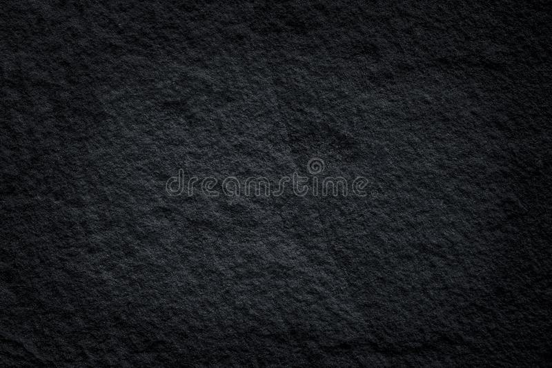 Black slate stone patterns or dark grey stone texture natural abstract on background. Close up Black slate stone patterns or dark grey stone texture natural stock photo