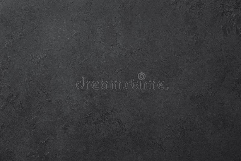 Black slate or stone texture background. Horizontal royalty free stock photo