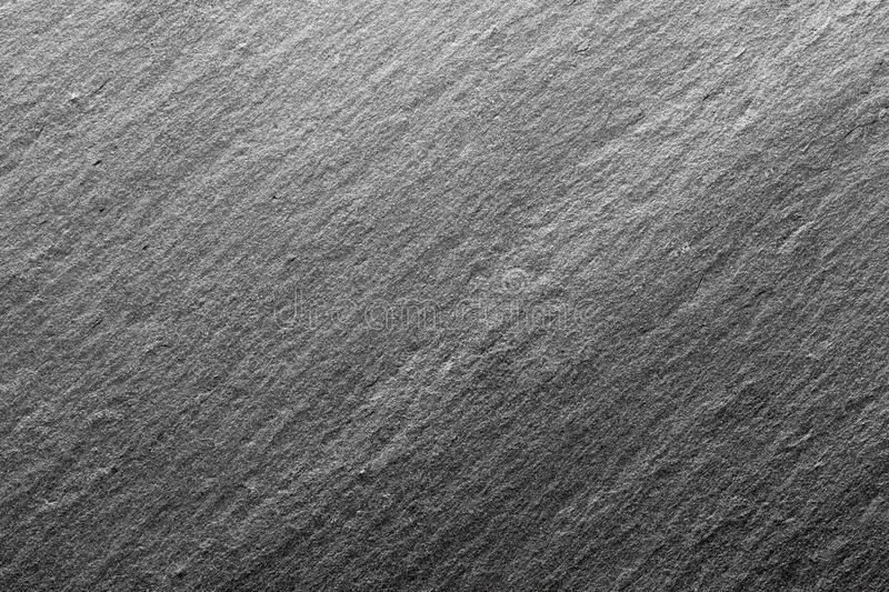 Black slate texture, floor tile, wallpaper or background. Rough texture with fine details royalty free stock image
