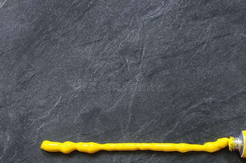 Black slate with yellow line. Background, black slate stone with texture and yellow line royalty free stock images