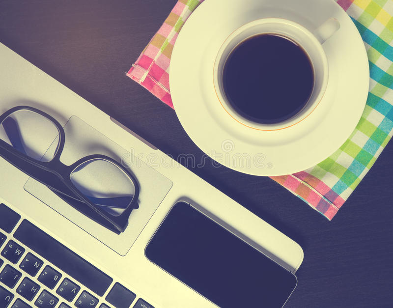 Black Smart phone screen on office coffee desk royalty free stock photography