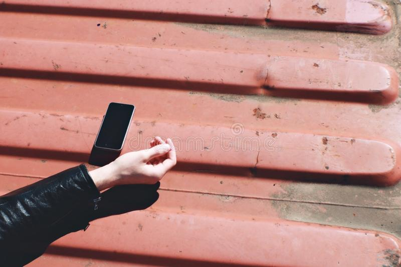 Black Smartphone Near Human Hand royalty free stock photos