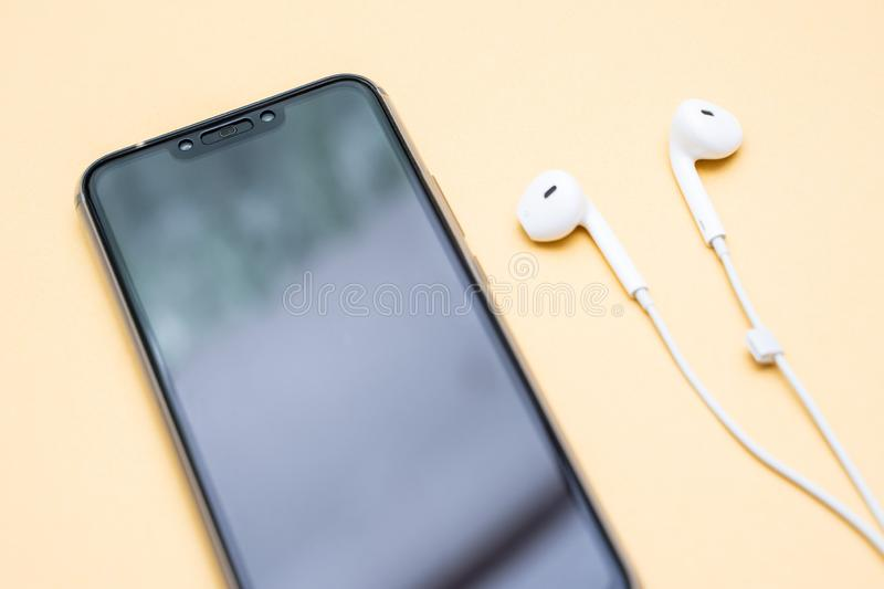 Black smartphone and white earphone royalty free stock photos
