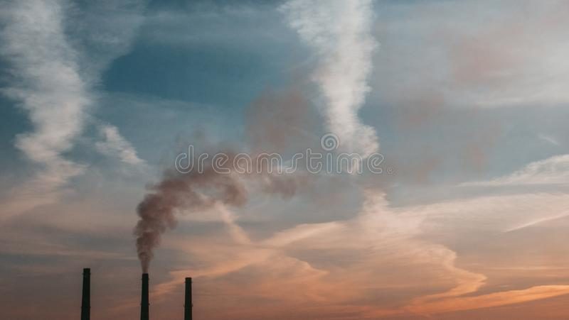 Black smoke comes out of the chimney stock photo
