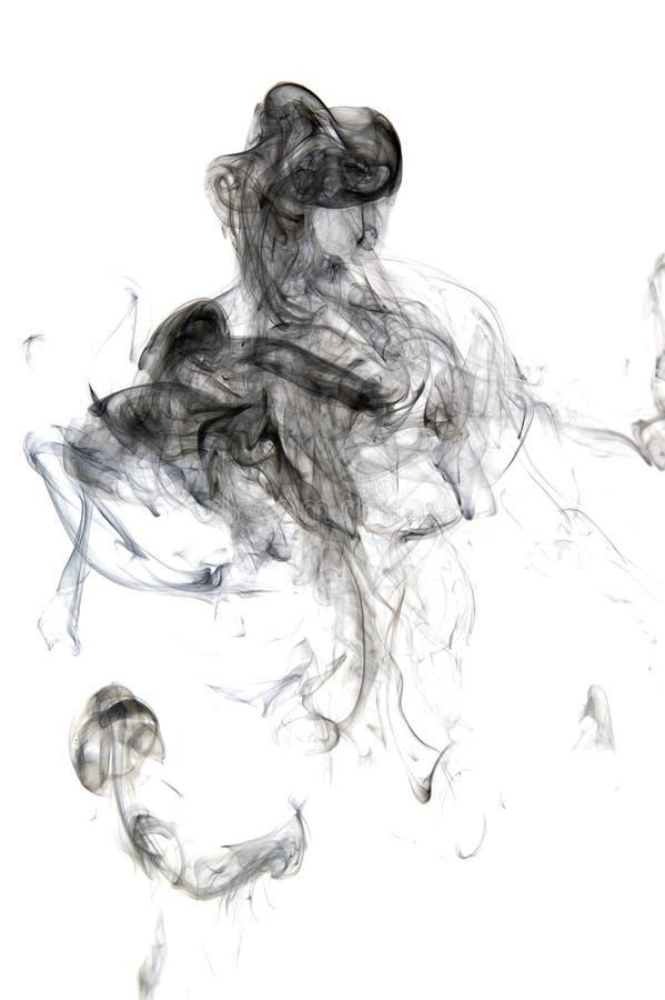 Black smoke isolated on white background stock images