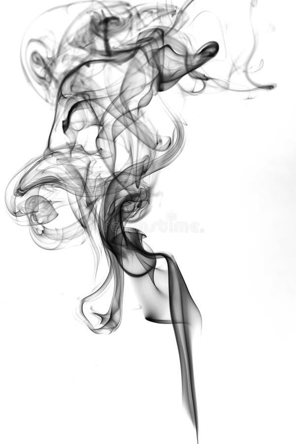 Black smoke on white background stock photos