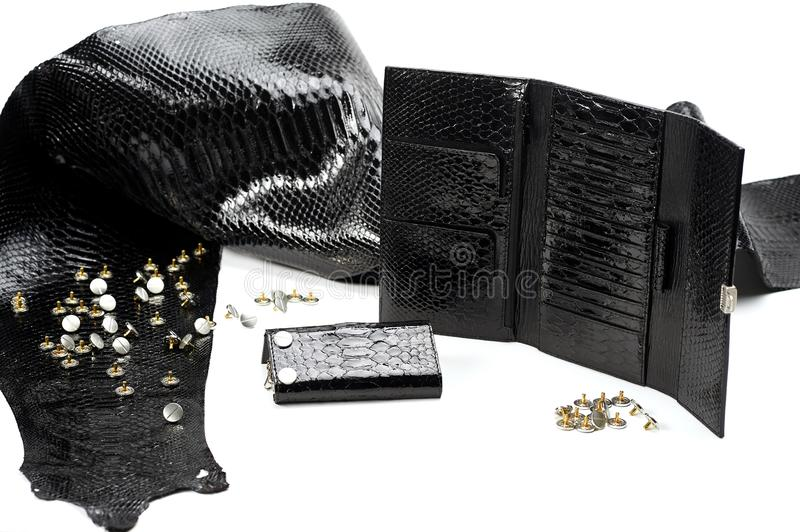 Black smooth pieces of leather look like reptile skin royalty free stock photo