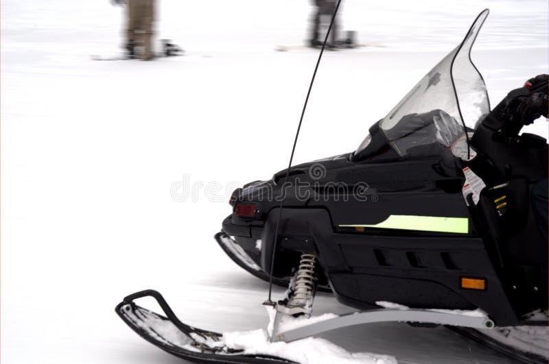 Black Snowmobile royalty free stock photos