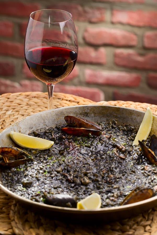 Black spanish paella stock photos