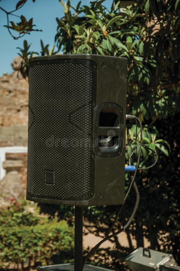 Black speaker on a garden at the Roman Theater of Merida. Close-up of black speaker on a garden in a sunny day at the Roman Theater of Merida. Founded by ancient royalty free stock image
