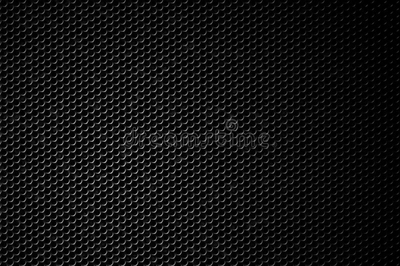 Black speaker grill. Texture of black speaker grill with clipping path to mask the holes stock photo