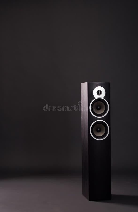 Black speaker tower. Single black speaker tower isolated in a studio stock photography