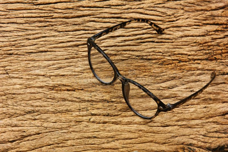 Spectacles on brown vintage wood background.short-sighted person with spectacles is appropriate. Black spectacles on brown vintage wood background.short-sighted stock photo