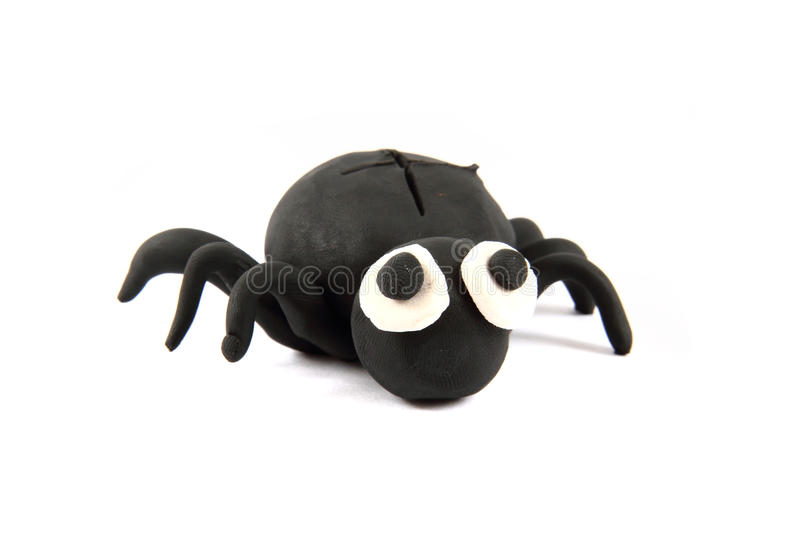 Black spider from the plasticine. Isolated on the white background royalty free stock image