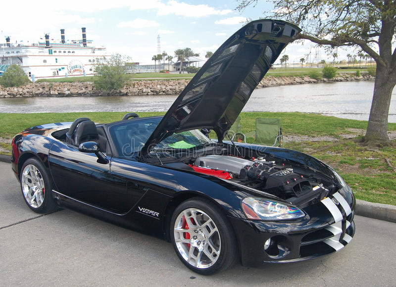 Black SRT 10 Viper. Expensive sports car made by Chrysler. It was designed by a man, Winkles, who lived in Italy. It was made for speed and unless you know what stock photography