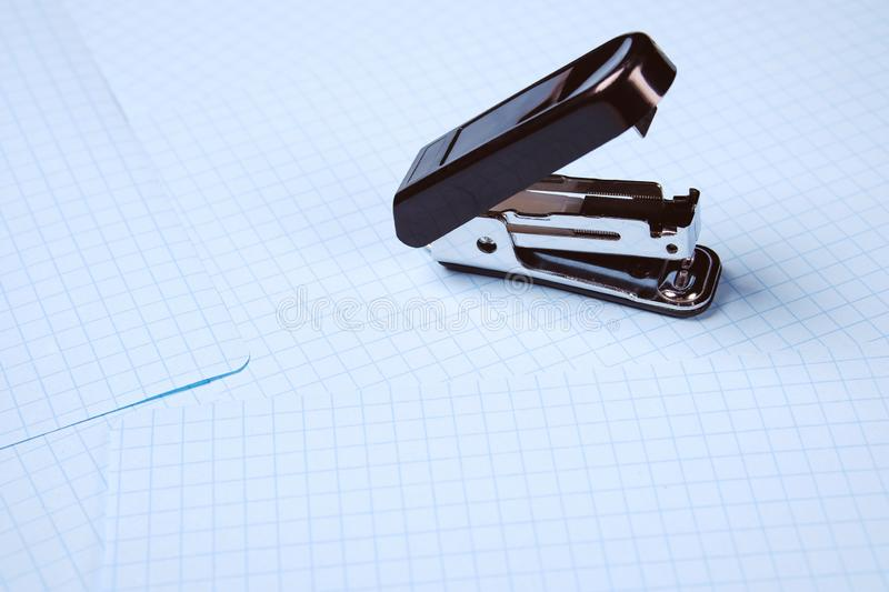 Black stapler isolated on white background. School and office supplies on the desktop. Copy space. The concept of school and royalty free stock photography