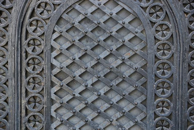 Black steel texture of forged pattern on old gate stock image