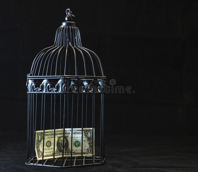 Black Steel Pet Cage With One Dollar stock photography