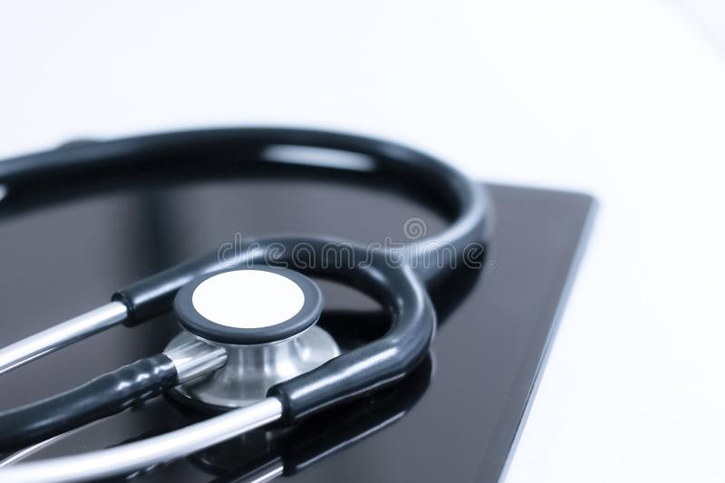 Stethoscope and tablet stock photo