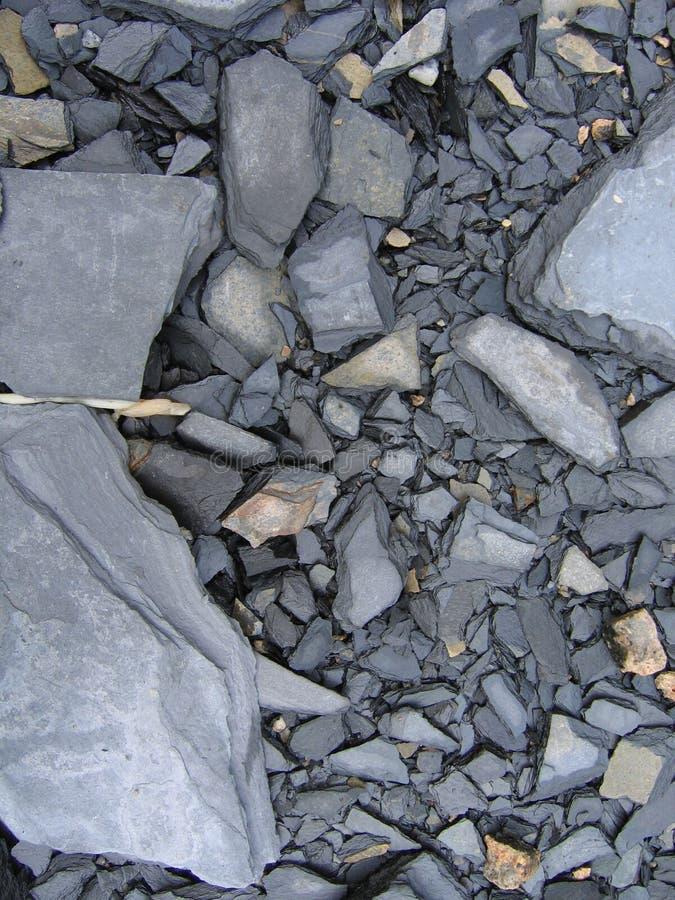 Black stone. Close up of broken stone surface stock photo