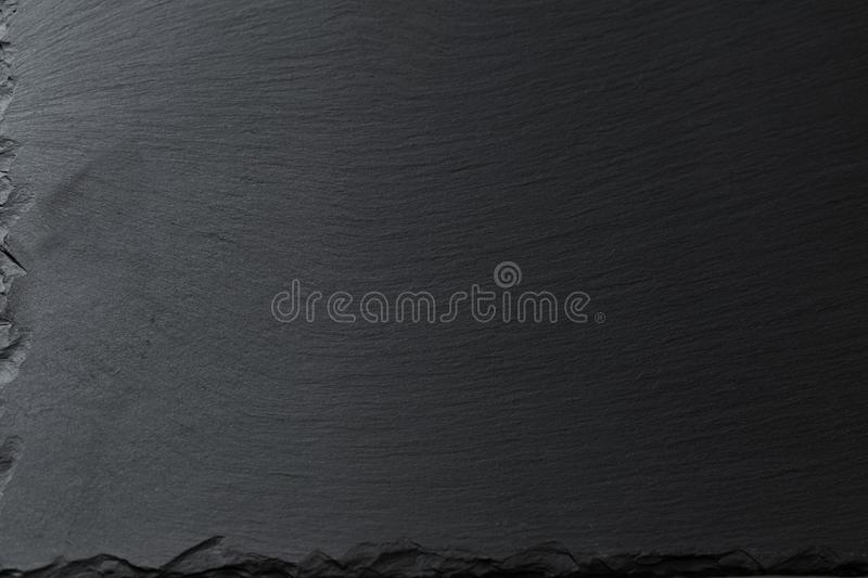 Black stone background. The granite black stone background royalty free stock photography