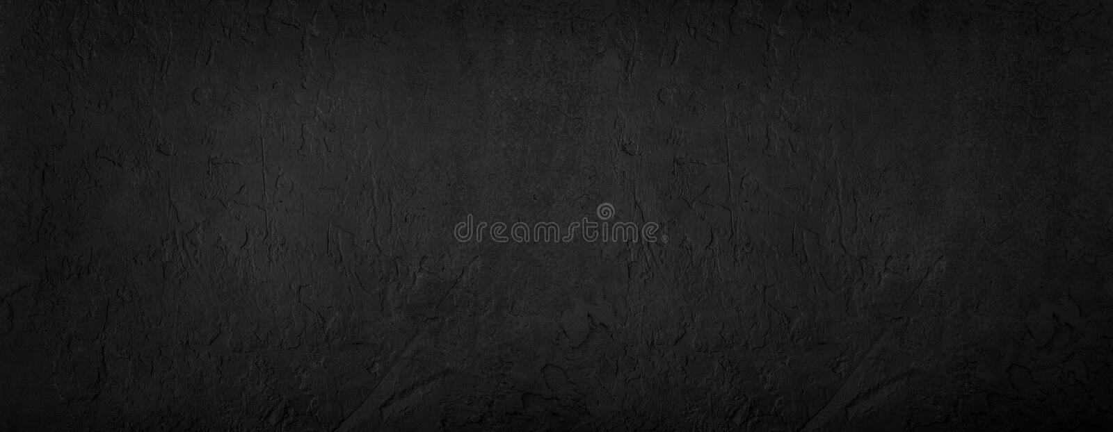Black stone background, grey cement texture. Top view, flat lay.  royalty free stock image