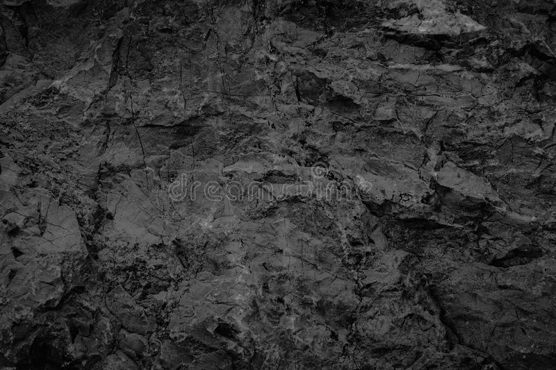 Black stone background texture, cracked texture used design for. Background royalty free stock image