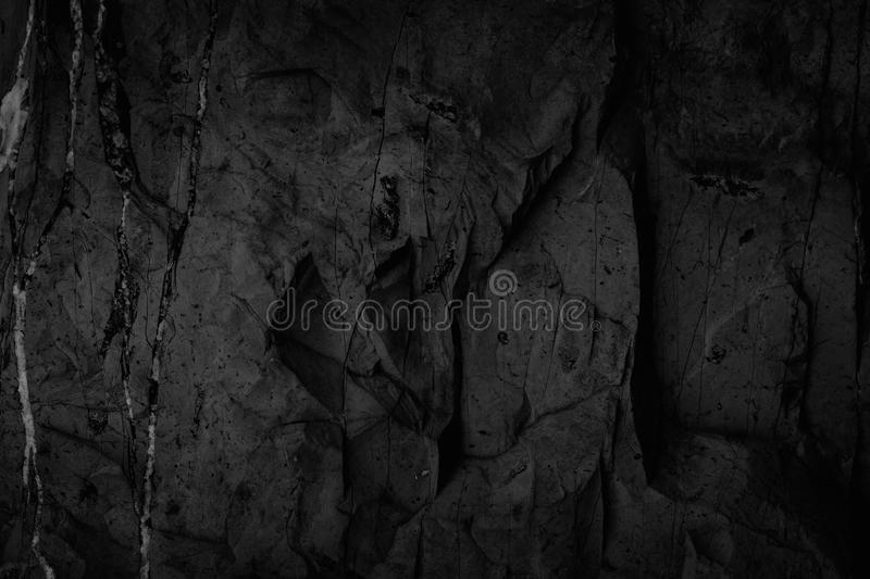 Black stone background texture, cracked texture used design for. Background stock image