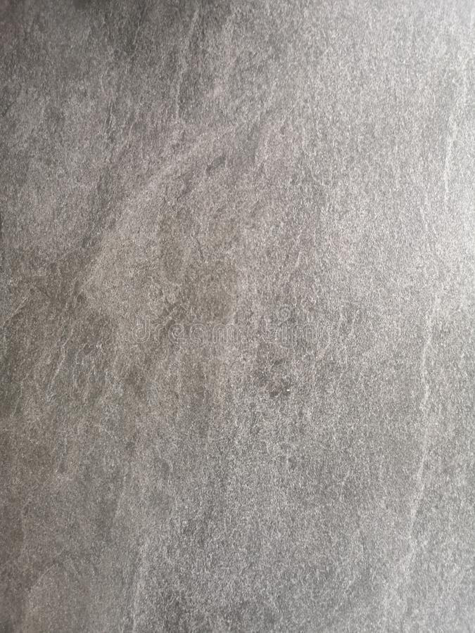 Granite floor Black stone rough surface texture material hard gray color background wall royalty free stock image