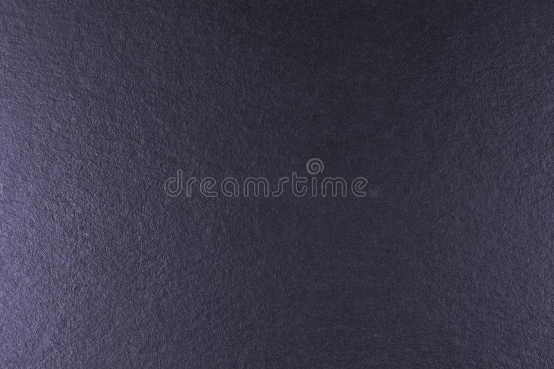 Black stone or slate background, black texture stock images